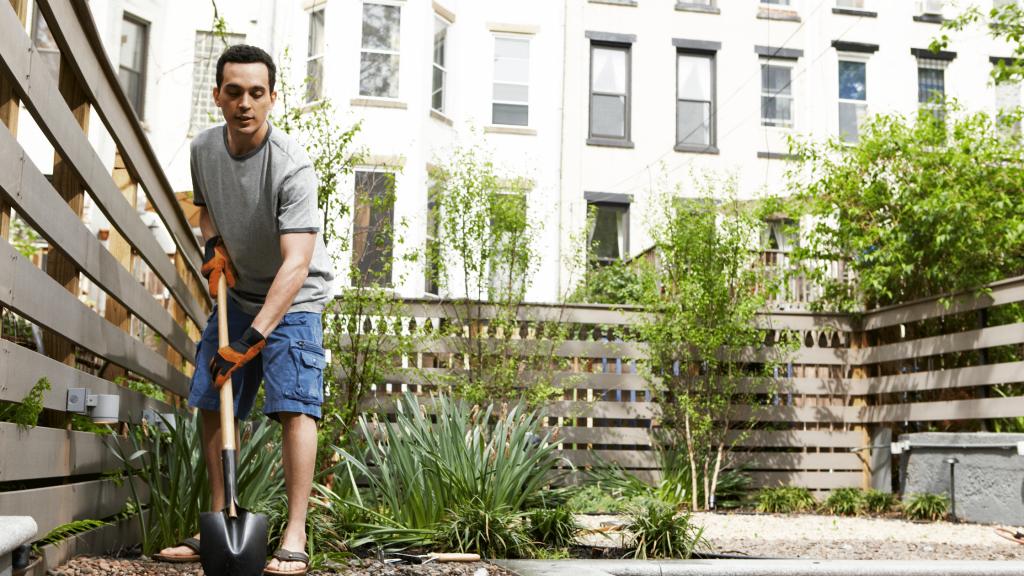 man gardening on an urban homestead